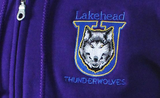 Logo Embroidery for Universities, Schools and workwear. Lakehead University in Orillia use Artech Promotional Embroiders for their professional service and embroidery that makes an impact. THese Timberwolves Hoodies sell quick at the university because they are affordable but still have great product qualities and warmth.